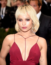 Zoe Kravitz stepped up the drama with a heavy application of red-tinged eyeshadow.