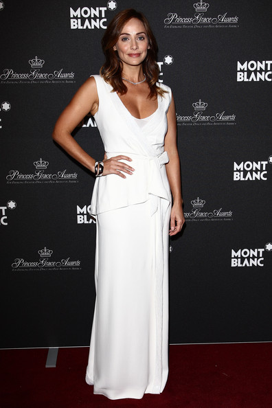 Natalie Imbruglia was elegant in a white sleeveless wrap long dress with sequin detailing.