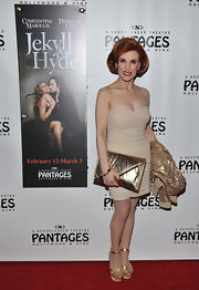 Kat Kramer topped off her all-gold look with an over-sized gold envelope clutch at the 'Jekyll & Hyde' red carpet.