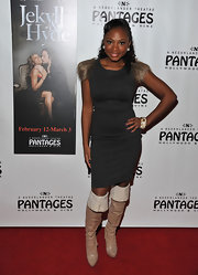 Naturi Naughton paired knee high boots with a cocktail dress for added style and flare.