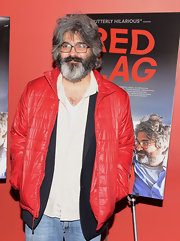 Onur Turkel opted for a bright red puffer jacket for the red carpet screening of 'Red Flag.'