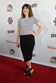 Mandy Moore chose a basic black pencil skirt to team with her top.