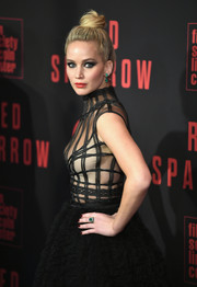Jennifer Lawrence accessorized with a Lorraine Schwartz emerald ring and matching earrings for the New York premiere of 'Red Sparrow.'