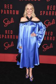 Joely Richardson coordinated her dress with a pair of blue and black crisscross-strap sandals.