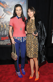 Wendi Deng matched her blue pants with a pair of platform pumps.
