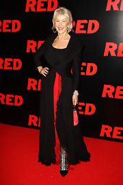 Actress Helen Mirren  arrived at the UK film premiere of 'Red' at the Royal Festival Hall wearing black lace and satin Swarovski crystal booties.