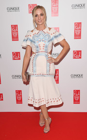 Joanne Froggatt opted for silver accessories, including a pair of classic ankle-strap sandals by Jimmy Choo.