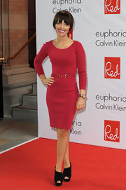 Katie Piper kept her red carpet look classic in a chic red sweater dress with a waist accentuating belt.