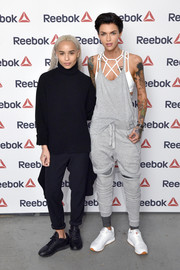 White Reebok leather sneakers completed Ruby Rose's ensemble.