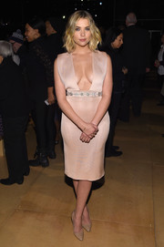 Ashley Benson stole the thunder from the Reem Acra models in a blush-colored cocktail dress with an embellished waist and a dangerously sexy plunge.