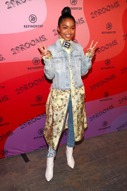 Yara Shahidi layered a faded denim jacket over a print dress and jeans for the 29Rooms New York 2018 opening party.