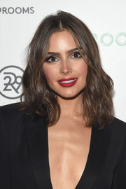 Olivia Culpo finished off her bold look with matte red lips.