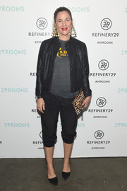 Drew Barrymore topped off her outfit with a black leather jacket.