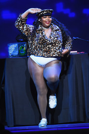 Lizzo performed at the Refinery29 Presents: The World of Abundance event wearing a leopard-print moto jacket and a matching cap.