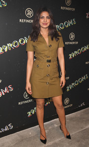 Priyanka Chopra was safari-chic in this belted tan shirtdress by Michael Kors during the 29Rooms event.