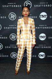 Yara Shahidi looked playfully chic in a gold gingham-print pantsuit by Brock Collection at the Shatterbox celebration.