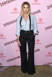 Ashley Benson added a '70s touch with a pair of black bell-bottoms.