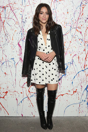 Chloe Bennet arrived for the 29Rooms: Turn It Into Art event wearing a black leather jacket over a polka-dot dress.