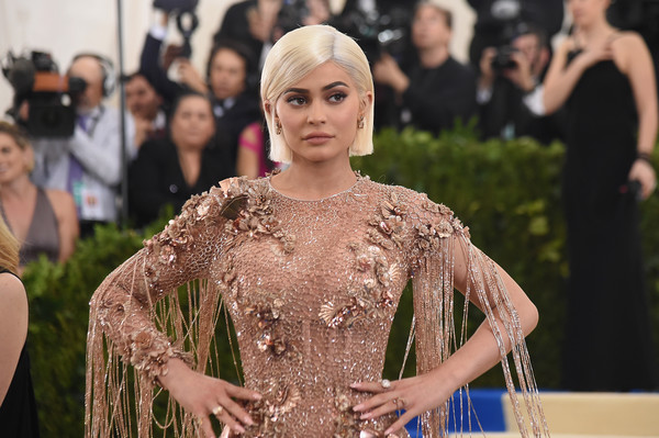 More Pics of Kylie Jenner Metallic Purse (1 of 52) - Kylie Jenner Lookbook - StyleBistro [rei kawakubo/comme des garcons: art of the in-between,rei kawakubo/comme des garcons: art of the in-between,dress,fashion,yellow,lady,beauty,shoulder,hairstyle,haute couture,gown,event,costume institute gala - arrivals,kylie jenner,new york city,metropolitan museum of art,costume institute gala]