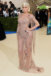 Kylie Jenner worked an embellished blush mesh gown by Atelier Versace at the 2017 Met Gala.