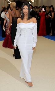 This angelic Vivienne Westwood off-the-shoulder gown Kim Kardashian wore to the 2017 Met Gala was a refreshing change from her signature skin-revealing style!