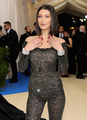 Bella Hadid gave her sexy catsuit an ultra-luxe boost with a pair of Bulgari Serpenti bracelets when she attended the 2017 Met Gala.