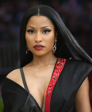 Nicki Minaj stuck to her signature ultra-long, straight hairstyle when she attended the 2017 Met Gala.