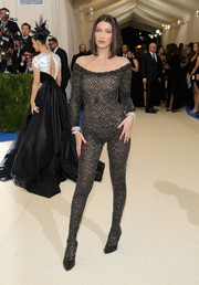Bella Hadid commanded attention in a black mesh catsuit by Alexander Wang at the 2017 Met Gala.