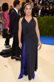 Salma Hayek punched up her look with a pair of hip-high electric-blue spandex boots, also by Balenciaga.