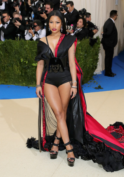 Nicki Minaj teetered on a pair of black triple-strap platform sandals by Versace at the 2017 Met Gala.