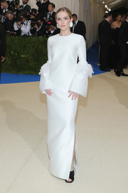 Zoey Deutch looked very refined at the 2017 Met Gala in an ivory Tory Burch column dress with ruffle-accented bell sleeves.