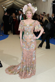 Haley Bennett attended the 2017 Met Gala looking like the goddess of spring in a nude Dolce & Gabbana Alta Moda lace gown with metallic panels.
