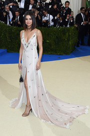 Selena Gomez was boudoir-glam in a pale-pink slip dress by Coach at the 2017 Met Gala.