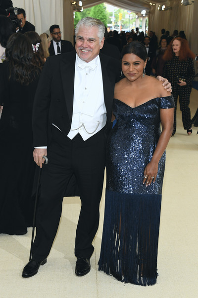 More Pics of Mindy Kaling Chignon (2 of 11) - Mindy Kaling Lookbook - StyleBistro [rei kawakubo/comme des garcons: art of the in-between,rei kawakubo/comme des garcons: art of the in-between,event,formal wear,suit,fashion,dress,tuxedo,haute couture,gown,ceremony,smile,costume institute gala - arrivals,r,mindy kaling,new york city,metropolitan museum of art,costume institute gala]