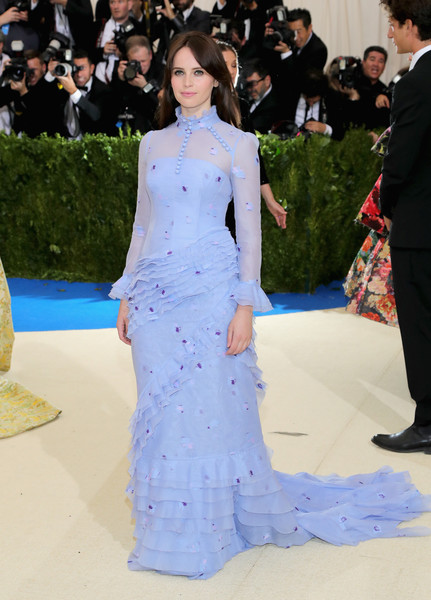 Felicity Jones went for a Victorian vibe in a long-sleeve, high-neck periwinkle ruffle gown by Erdem at the 2017 Met Gala.