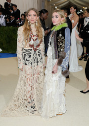 Mary-Kate Olsen joined the sheer trend while also sticking to her signature boho style with this white open-work maxi dress at the 2017 Met Gala.