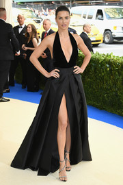 Adriana Lima flaunted major skin in a high-slit, deep-V halter gown by Alberta Ferretti at the 2017 Met Gala.