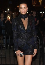 Adriana Lima teamed a Giuseppe Zanotti satin clutch with a sexy mini dress for the Met Gala after-party.