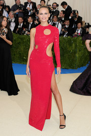 Natasha Poly kept it fun and playful in a one-sleeve, multi-cutout gown by Michael Kors at the 2017 Met Gala.