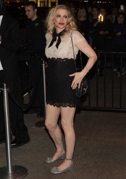 Courtney Love completed her outfit with silver glitter flats.
