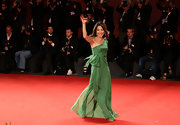 Actress Michelle Yeoh looked regal in a pale green resort gown accessorized with a gold clutch.