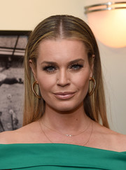 Rebecca Romijn paired her hairstyle with chic diamond hoops.