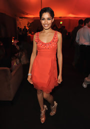 Freida Pinto wore a sweet tangerine frock with a beaded neckline for the 'Immortals' after-party.