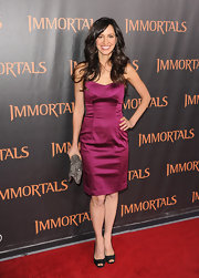 Charlene Amoia was chic in a deep purple satin cocktail dress paired with black peep-toe pumps.