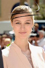 Beatrice Borromeo topped off her look with a black feather fascinator.