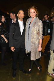 Lily Cole attended the 'Reluctant Fundamentalist' pre-party wearing an elegant brocade coat.
