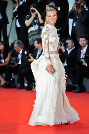 Fiammetta was a stunner in this feathered white gown and down-to-there ponytail at the Venice Film Festival.