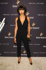 Jackie Cruz styled her outfit with gold pumps and a matching shoulder bag.