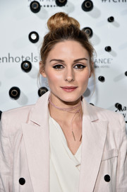 Olivia Palermo worked a mildly messy top knot at the Renaissance New York Midtown Hotel launch.
