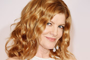 Rene Russo Medium Wavy Cut